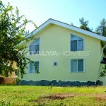 detached-house-surrounded-by-greenery-in-dosemealti-004.jpg