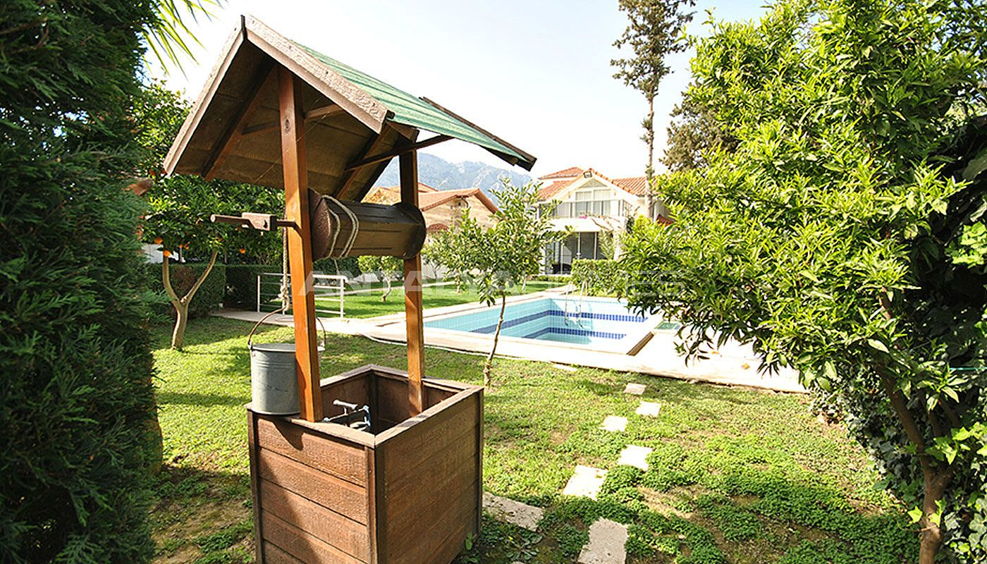 kemer-house-with-furniture-surrounded-by-greenery-003.jpg