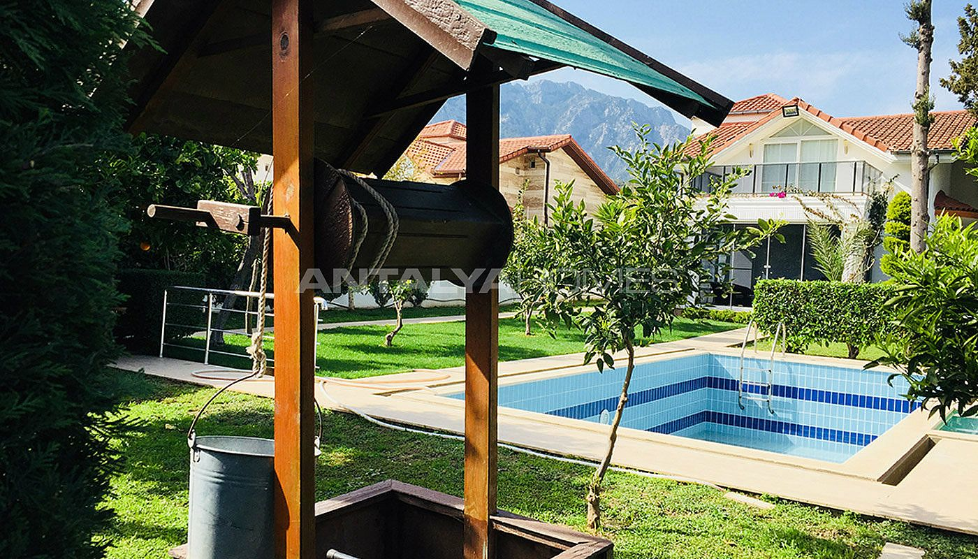 kemer-house-with-furniture-surrounded-by-greenery-005.jpg